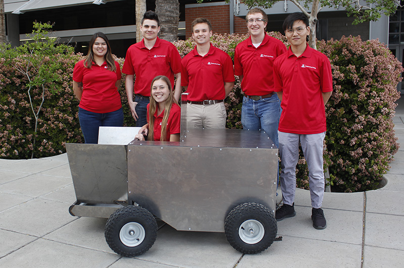 Students stand with project prototype on UArizona campus