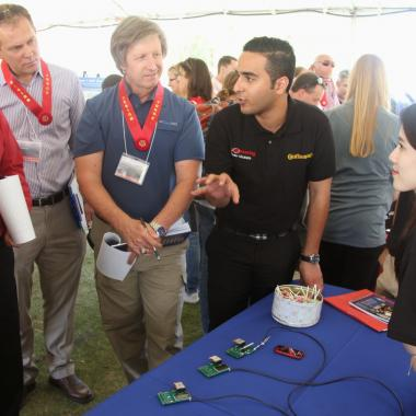 Judges interview a team at Engineering Design Day