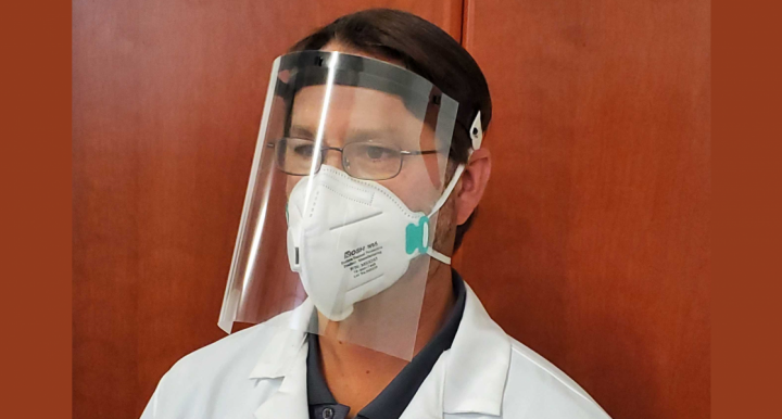Image of a doctor wearing a face shield and mask